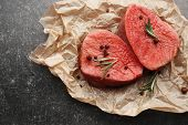 Fresh raw meat on parchment paper poster