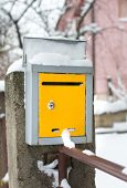 Snow Covered Mailbox In Front Of A House poster