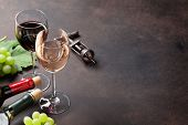 Wine glasses and grapes on stone table. With space for your text poster