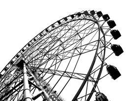 foto of ferris-wheel  - a ferris wheel at a local fun fair seen in silhouette - JPG