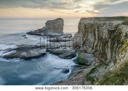 poster of Sunset Over Rocky Coastline Near Panther And Hole-in-the-wall Beaches. Bonny Doon, Santa Cruz County