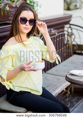 poster of Breakfast Time In Cafe. Girl Enjoy Morning Coffee. Woman In Sunglasses Drink Coffee Outdoors. Girl R