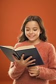 Reading Practice For Kids. Girl Hold Book Read Story Over Orange Background. Child Enjoy Reading Boo poster