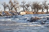 a small dam diverting water to farmland irrigation, South Platte River in eastern Colorado near Gree
