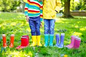 Little Kids, Boys And Girls In Colorful Rain Boots. Close-up Of Children In Different Rubber Boots,  poster