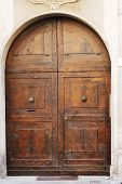 foto of wooden door  - Big wooden medieval door of old Italian convent - JPG