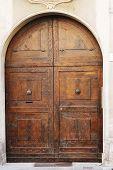 foto of wooden door  - Big wooden medieval door of old Italian convent - JPG