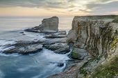 Sunset Over Rocky Coastline Near Panther And Hole-in-the-wall Beaches. Bonny Doon, Santa Cruz County poster