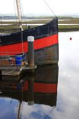 picture of sounding-rod  - bow of boat reflected in the sound at Irvine - JPG