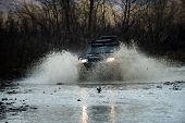 Off Road Vehicle Coming Out Of A Mud Hole Hazard, Mud And Water Splash In Off-road Racing. Scene Of  poster