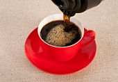 Black Expresso In A Red Coffee Cup On Canvas Background