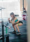 Young Fit Woman Doing Squats With A Rubber Band In The Gym. Functional Modern Training poster