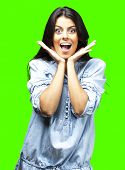 portrait of surprised young woman against a removable chroma key background