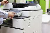 Men Press The Button Of The Copier. Man Copying Paper From Photocopier. Men Use Printing Machines. T poster