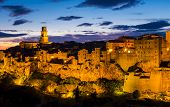 Stunning View Of Pitigliano At Dusk, Mediaeval Town In Tuscany, Italy poster