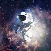 Astronaut exploring outer space conducting spacewalk. 3D Illustration. Some elements of this image f poster