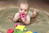 Baby Boy Biting Alphabet