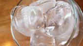 Icing Texture Closeup Of White Transparent Ice Cubes Inside Wine Glass. Frozen Textured Background.  poster