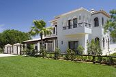Beautiful villa with a healthy garden at Algarve on a sunny day, south of Portugal
