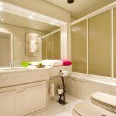 Luxury bathroom with brown tiles