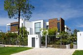 Street view of a beautiful villa with a healthy garden at Algarve on a sunny day