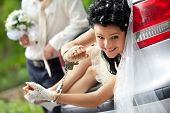 Groom discharging of captive bride from car trunk