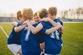 Happy Kids In School Sports Team. Boys Gathering And Having Fun On Sports Field. Cheerful Children B poster
