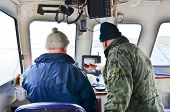 On fishing boat - studying a sonar screen