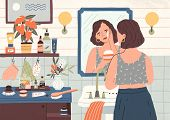 Cute Young Woman Standing In Front Of Mirror And Cleansing Or Moisturizing Her Skin. Everyday Person poster