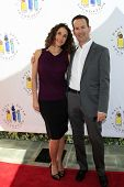 LOS ANGELES - MAR 4:  Melina Kanakaredes, Darryl Frank arrives at the  Have A Dream Foundation's 14t