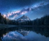 Milky Way Over Antorno Lake At Night. Summer Landscape With Alpine Mountains, Trees, Blue Sky With M poster