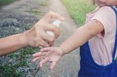Hand Spraying Insect Or Mosquito Repellents On Skin Girl, Mosquito Repellent For Babies, Toddlers Th poster