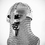 Metal, Viking helmet with chain mail in a black mannequin on white background. clothes for the vikin poster