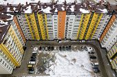 Aerial Winter Top View Of Tall Apartment Building, Brick Chimneys, Tiled Roof. Urban Infrastructure, poster