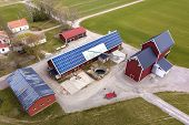 Top View Of Rural Landscape On Sunny Spring Day. Farm With Solar Photo Voltaic Panels System On Wood poster