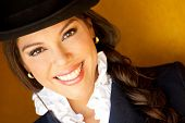 Beautiful horsewoman portrait wearing a hat and smiling