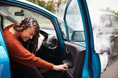 Female Motorist With Whiplash Injury In Car Crash Getting Out Of Vehicle poster