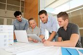 stock photo of young men  - Educator with students in architecture working on electronic tablet - JPG