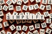 Simplify Word Concept On Wooden Cubes For Articles poster