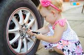Lillte Child Playing In Auto Mechanic