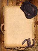 picture of horseshoe  - Western background with cowboy hat and horseshoes for design - JPG