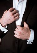 foto of cuff  - Closeup of a man in black suit with cuff - JPG