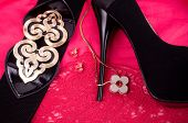 Beautiful accessories jewelry, and shoes on a red background