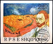 ALBANIA - CIRCA 1990: A stamp printed in Albania shows the work: Wheatfield with Crows and self-port