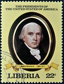 A stamp printed in Liberia shows President James Madison circa 1982