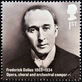 A stamp printed in Great Britain shows Frederick Delius Opera choral and orchestral composer