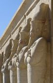 pic of mortuary  - architectural detail of the Mortuary Temple of Hatshepsut in Egypt with stone sculptures in a row - JPG