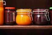 stock photo of jar jelly  - Jars of jam on a shelfof Jam - JPG