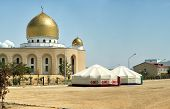 image of yurt  - Mosque in the city of Aktau stand near the yurt - JPG