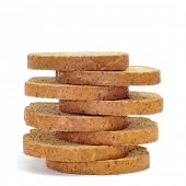foto of whole-wheat  - a pile of whole wheat rusks on a white background - JPG
